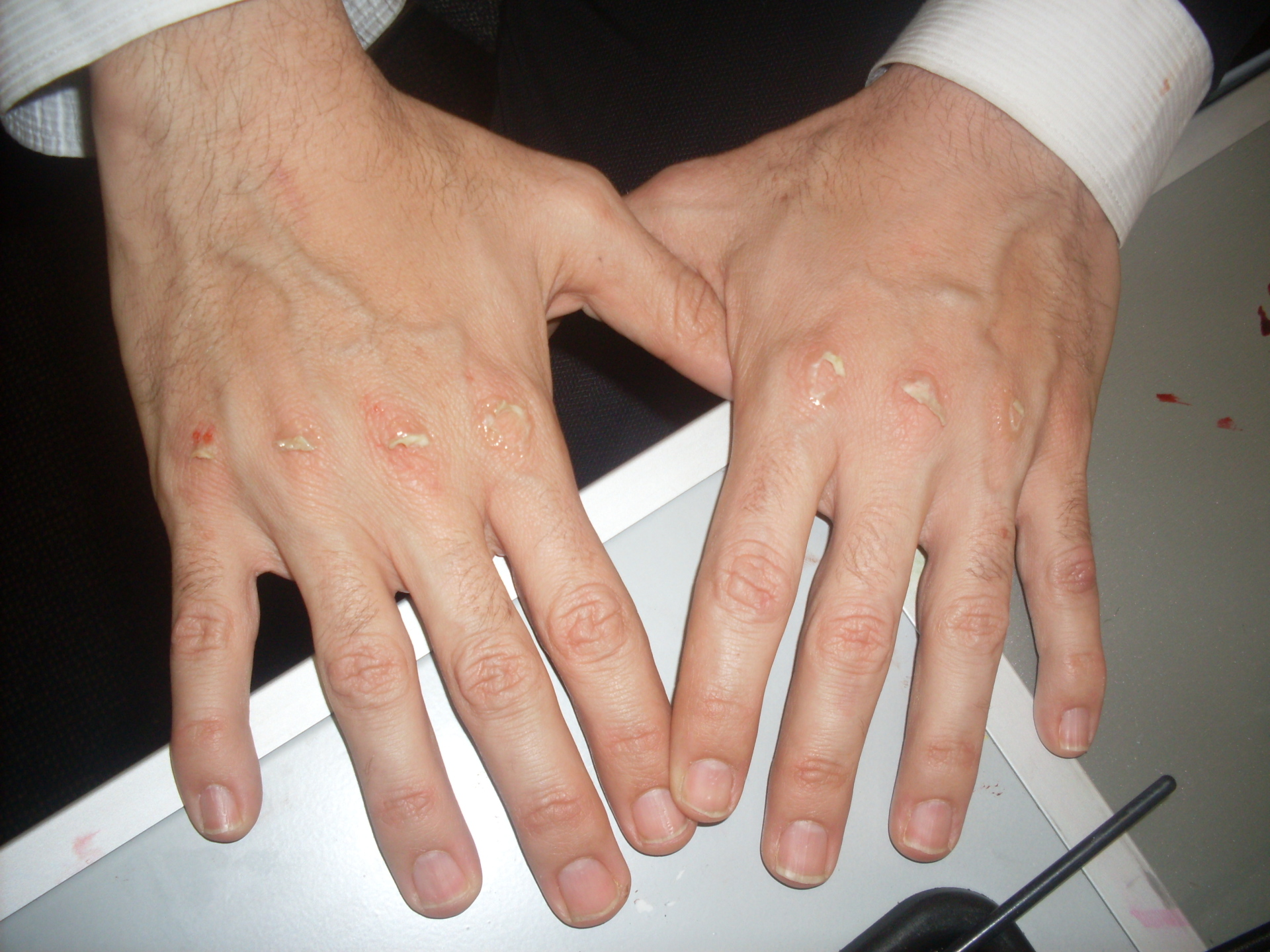 mans hands preparing for movie makeup special effects